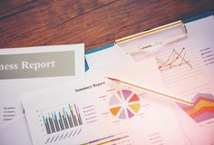 Business report chart preparing graphs concept Summary report in Statistics circle Pie chart on paper business document financial royalty free stock image