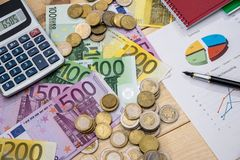 Business report with euro coin. And banknotes Stock Image