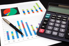 Business report  graph with pen and calculator Stock Photos