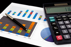 Business report  graph with pen and calculator Stock Image