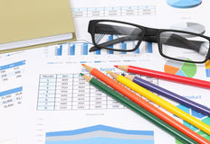 Business report and pencils Stock Photography