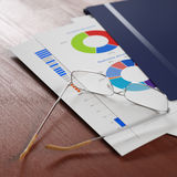 Business report. In plastic folder and eyeglasses over it, some figures are visible. Shallow DoF Royalty Free Stock Photography