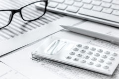 Business report preparing with calculator and glasses on office background. Business report preparing with calculator and glasses on office desk background Stock Photos