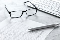 Business report preparing with calculator and glasses on office background. Business report preparing with calculator and glasses on office desk background Stock Image