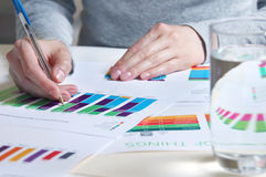 Business report review. Reviewing business report with charts and graphs Stock Image