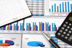 Business Report Still Life. Business Report with Calculator, Notepad and Pen Royalty Free Stock Image
