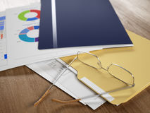 Business reports. And documents, eyeglasses over it, some figures are visible. Shallow DoF Royalty Free Stock Image