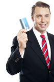 Business representative showing credit card. To camera and smiling while facing camera Royalty Free Stock Photo