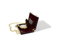 Business Retirement. Gold pocket watch with a metal chain in burgandy leather Briefcase used to carry items to the office Royalty Free Stock Photography