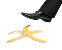 Business risk. Concept: boot to step on a banana skin Stock Photo