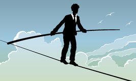 Business Risk. An illustration of a man walking a tightrope. A business risk concept Royalty Free Stock Images
