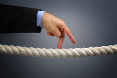 Business risk. Businessmans fingers walking the tightrope concept for business risk or leadership Stock Photos