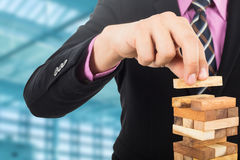 Business risk concept with wood jenga game Royalty Free Stock Images