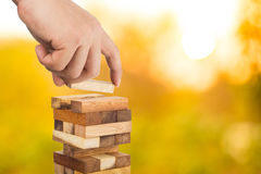 Business risk concept with wood jenga game Royalty Free Stock Photos