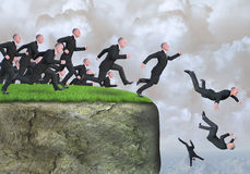 Business Risk Management, Sales, Marketing, Strategy. A group of businessmen or business people are running like lemmings off a cliff. Abstract concept for Royalty Free Stock Image