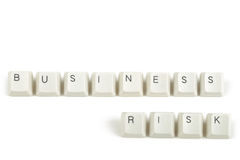 Business risk from scattered keyboard keys on white Royalty Free Stock Image