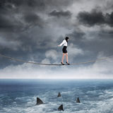 Business risk with woman on the rope Royalty Free Stock Images