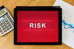 Business risk word on digital tablet Stock Photos