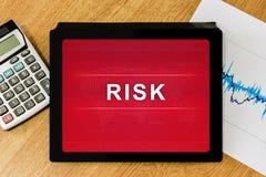 Business risk word on digital tablet Stock Photos