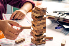 Business risks in the business. Requires planning Meditation must be careful in deciding to reduce the risk in the business. As the game drew to a wooden block stock image