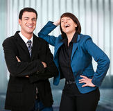 Business-rivalry 10. Friendly businessteam is laughing into the camera Stock Images