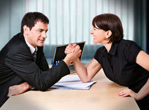 Business-rivalry 4. Businesswoman and businessman are fighting Royalty Free Stock Photos