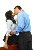 Business romance. Young love couple embraces on white background Stock Photography