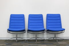 Business room. Three blue chairs in business office Royalty Free Stock Photo