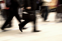 Business rush hour. Business people rushing in the street in motion blur Stock Photo