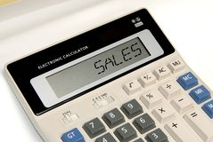 Business sales. A word sales display on calculator screen Royalty Free Stock Photos