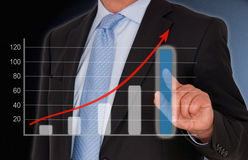 Business and Sales Performance uptake chart. Businessman with touchscreen royalty free stock photography