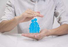 Business salesman agent hand holding family icon stock image