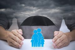 Business salesman agent hand holding family icon stock images