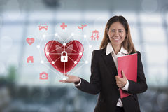 Business salesman agent hand holding red heart. concept accident royalty free stock image