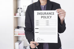 Business salesman agent showing protection policyholder. Must to sign. concept accident prevention healthcare insurance Stock Image
