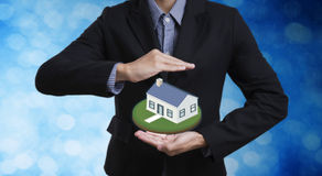 Business salesman hand protection home concept home insurance Royalty Free Stock Photos