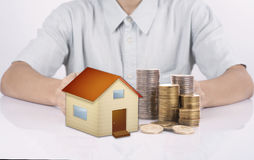 Business salesman hand protection home with money. Stock Image