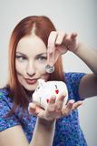 Business savings of a woman. With a piggy bank Stock Images