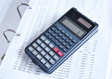 Business scene with calculator and files. Workplace close up stock photo