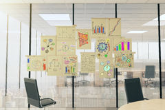 Business scheme concept posters on vitreous wall in light office Stock Images