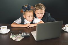 Business or school kids uses a laptop computer Stock Image