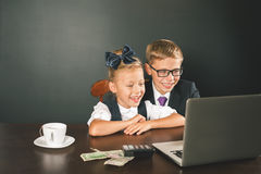 Business or school kids uses a laptop computer Royalty Free Stock Photos