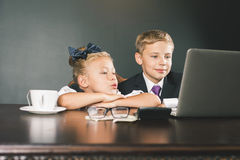 Business or school kids uses a laptop computer Stock Photography