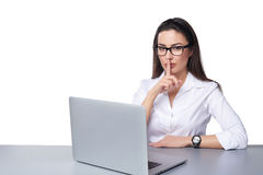 Business secret concept. Business woman working on a laptop making hush sign, isolated over white Royalty Free Stock Photography