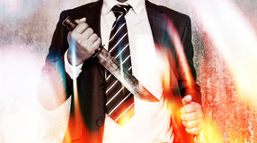 Business Security. Business competition,Businessman bring out knife ready to fight or protect business Royalty Free Stock Photo