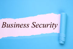 Business security. Text torn paper Stock Images
