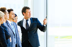 Business seminar where a boss explaining Stock Image