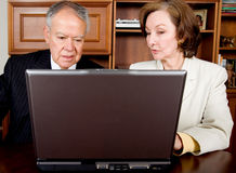 Business senior couple on a laptop Stock Photo