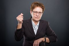 Free Business Senior Lady Showing Time Is Money Gesture Stock Photography - 108437662