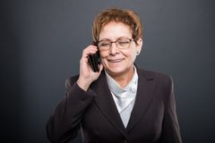 Business senior lady talking at mobile phone Stock Images